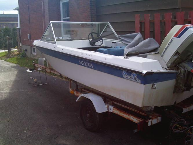 14' fiberglass runabout with 85 OMC outboard (trailer extra)