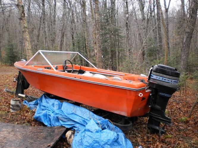 14 foot fibreglass boat, 50HP mercury motor and trailer