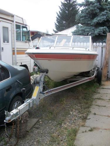 16.5 Vanguard motor boat and trailer