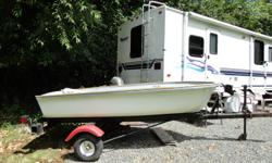 Nice little lake boat, 10 1/2 foot with wooden oars and trailer.