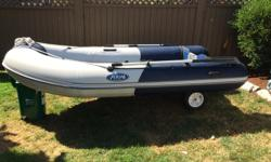 Excellent used condition Zodiac Zoom boat with soft bottom but interlocking plywood floor to create hard surface. Maximum HP 15. No trailer, comes with rear wheels for easy transport. No air leaks or patches. Stored indoors and used only seasonally.