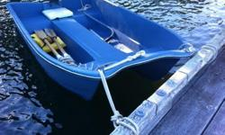 -11 foot fiberglass Livingston tender -2.5 HP Yamaha 4-stroke engine