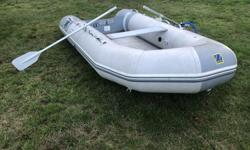 11.5 ft Zodiac with air floor comes with oars good over all condition a couple of repairs.