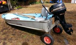 12-foot Aluminum boat with 7.5 HP Mercury Outboard motor and launch wheels. Comes with a metal gas tank, one cushioned seat and two oars. I installed the launch wheels and replaced the transom last year. Motor was tuned up last year and runs well. I have
