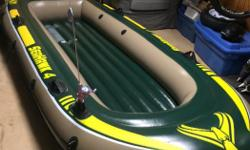 Intex Seahawk 4 inflatable boat in excellent condition. Comes packed in a plastic tote bin with kicker bracket, rod holders, oars and air pump. I'm also including a really cool old Ted Williams electric trolling motor that works great, just add a battery