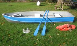 12 foot Aluminum boat in good condition with no leaks. There is one area that's dented and repaired. Has new transom and a fresh coat of paint. Swivel seat has been recovered in marine vinyl. Comes with two oars, a 15lb anchor. and three life vests,
