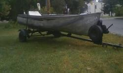 Set up with carpeted platform, storage bench and rear seat. Great fishing boat for small lakes for two guys. Does not leak went over every rivet and has new sealant on every seam. Comes with a 36lbs trolling motor. Trailer has ownership, brand new lights,