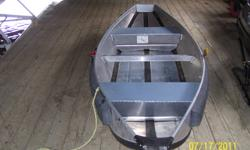 """Brand new used two times, ideal for carrying in the bush on Quad or Airplane. Weighs only 50lb's.Assembles in ten minutes.  Three man capicity, and will take 2hp. motor. If you use this boat you""""ll never use a rubber boat again."""