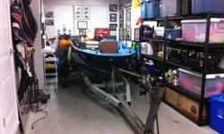 12ft. Hourston fiberglass boat w/trailer....No motor