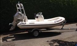 12ft Nautica inflatable, with Honda 40hp- 4 stroke motor/ power tilt, on 2013 EZ Loader trailer