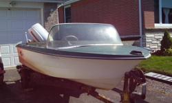 """13' fiberglass Crestliner Mustang with 40 hp Evinrude outboard, in good condition (16' Wiscott roller boat trailer with 8"""" tires and good lights, in good condition $500. extra. Not trailer in picture. )"""