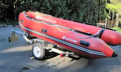14' Saturn inflatable boat with marine plywood floor. Rated for up to 40 hp outboard. Comes with manual pump, repair kit & one pedestl seat. Road runner trailer upgraded with new springs, hubs, bearings, tires, fenders & coupler. Also rewired.