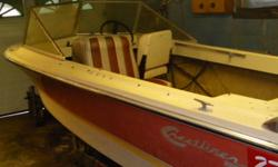 """14.5 ' fiberglass Crestliner runabout with brown top fish finder 50 hp Evinrude in good condition, ( 16' boat trailer with 13"""" tires and spare, tounge jack, $600. extra )"""