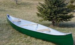 14.5 Fibreglass canoe, like new-refurbished, all repairs done, new paint inside and out, new seats and yoke. No gel coat cracking. Aluminum gunnels. Comes with a aluminum removeable outboard motor mount. Wide and stable good for kids, cottagers or