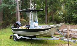 Very solid welded aluminum center console boat made in Sooke 2 ft pontoon on stern with motor mounted on. 16.5 ft including pontoon. Comes with trailer 115 hp Mercury - well maintained, new impeller, new prop, new leg fluid, and 130 compression on all