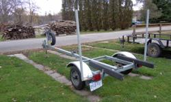 14' Boat trailer in excellent condition.  Suitable for aluminum boat.  New spare tire included.
