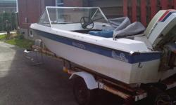 """14' fiberglass Prince runabout with tonnau cover and 85 hp Evinrude outboard ( 16' bunk boat trailer with 12"""" tires, good lights, in good condition $500. extra. )"""