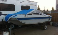 this 14 foot fiber glass boat with trailer as a 40hp engine that rocks, I bought it this summer to enjoye the lake with the other boats but familly whants to move back where we came from and i'd rater have a enclosed trailer. price can be discuss. NO DEAL