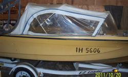 For Sale: 14 foot fiberglass power boat complete with 55 cc Viking outboard engine.  Boat is yellow with a little black on the bow.  Boat comes with a new EZ Loader boat trailer, 2 fuel tanks, fish finder, removable soft cover top / canopy.  Boat is in