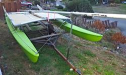 14' Hobie-Cat Good solid hulls Trampoline and sail in good shape Can be disassembled easily to transport in pickup truck Easy to sail, it's been in the family for many years. Trailer not included as we need it for our aluminum boat, but will gladly
