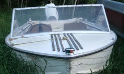 14 ft boat for sale 450.00 obo. motor run but leg does not move.  call 960-4203 or email l.holizki@inet2000.com