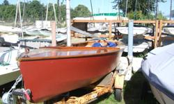 14 ft. Enterprise sailing dinghy No. 13381 Mahogany construction Holt Allen aluminum rigging Jeckells Jib and Main in great shape (very well made) Float bags Trailer Included (needs paint job) Custom canvas cover.