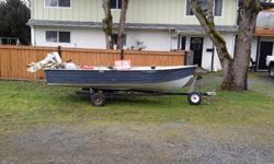 14 foot aluminum Lund boat. Comes with: 9.9 seahorse sail master / electric start 3 rod holders 2 swivel seats Hummingbird depth finder / fish finder Spare tire for trailer Gas tank 2,000 obo or trade for tent trailer