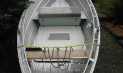 14ft Lifetimer Drift Boat on Ez Loader Trailer -Custom front storage seat/dry box and anchor system - 3 oars and 45 lb Pyramid anchor -Comes with spare oar locks and catch and release net -Very good condition