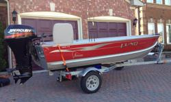 LUND 14 ft WC Adventure Model with 25hp MERCURY Big Foot 4 Stroke electric start motor. With KARAVAN galvanized trailer. Boat used only 4 times.  Like new.  Includes swivel aft seat, rod holders, dual oars, anchor & rope, and spare tire. $4700, or best