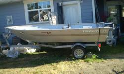 14 ft. Tracker, 15hp Evenrude. Two gas Tanks, Two Oars, Two High Back Seats, Two Scott Rod Holders, all on a Trailer. Excellent Condition. Boat and trailer are 4 years old.