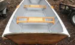 15.6' redmond design 'whisp'. marine grade epoxied plywood. c/w 8' spoon oars /bronze oarlocks.. Mint. 70lbs Txt or email