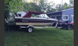 1988 16 ' Peterborough fibreglass boat, easy hauler trailer, cover and 40 hp Johnson. Runs great, has rod holders, Gas tank and line, Extra Prop, stereo and top. $2200 obo
