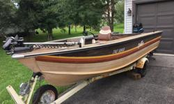 16.5 ft Sylvan Sea Monster complete with 50hp Mercury, Minn Kota foot pedal trolling motor, Eagle Ultra Plus fish finder, live well, leather seats, trailer with LED lights, spare prop, spare tire and cover.