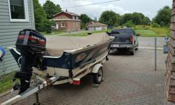 1998 Legend with 60 h/p Merc. 2 stroke(also 98), 16.5 ' with 40lb thrust front mounted trolling motor, live well, side console, & bimini top. e-mail only..
