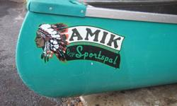 "16' Fiberglass canoe ""Amik"" by sportspal, very smoth, stable and maneuverable with hardwood portage yoke. Always stored indoors. Comes with two paddles."