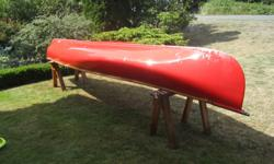 Older but sturdy 16 ft canoe, square stern allows electric motor attachment. Set of 4 adult size life jackets and 4 paddles make it ready to go!