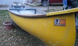 Good stable canoe with square stern for 2hp outboard. It has hardwood seats and mahogony gunwales. The keel is large for good tracking and it carries a huge payload with two paddlers. It's a great weekend river tripper for two and sports bright yellow