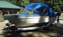 Full Canvass, 115 HP Mariner, Trailer, VHF, GPS/Depth Sounder, Built in tank plus 5 gal spare tank. Assorted fishing and safety equipment.