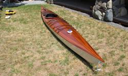 This boat was built by experienced woodworkers (www.coventrywoodworks.ca) . The hull is 4mm marine ply stitch and glue construction with cedar strip deck. The hull and deck both have 4 oz fibreglass cloth reinforced epoxy resin. Total weight is 64 lbs.
