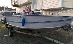 17.5 foot aluminum center console fishing boat everything in excellent condition 2 live Wells with a 75 HP motor just had complete service from reputable shop. Also includes kicker and trailer I replaced all the old switches with new wire and instrument