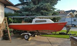 17 ft. Vandestadt and McGruer sailboat. Motor and trailer included. Complete package all ready to sail. Moved out of province and can't take it with me. 17 ft. Siren model with swing keel. One good set of sails (main and jib). 5hp. Tohatsu motor included.
