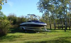 Barely used 2007 185 Sport Searay Boat with Shoreland'r Trailer.  We put a brand new 200+ Horsepower Mercruiser Engine and only has 5 hours on it.  The boat has 32 hours.  Comes with Safety Package, Wakeboard, WAter Ski's and Lifejakets.   Contact Mike
