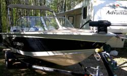 18 ft extreme legend, two live wells, two casting decks, locking rod storage, full stand up top, wireless trolling motor, 90 hp fuel injected four stroke merc., rod holders. asking 2700 used twice under factory warranty Ph 717-5664