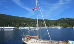James Barber's boat when new. We've owned her for 22 years. Designed by Carl Alberg, built at Whitby Boatworks. Fiberglass hull, deck and cabin. In great shape and well taken care of. Bronze portholes with bug screens. Wheel (with cable) and helm