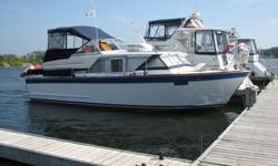 Turn Key boat! This boat is a classic beauty! Must be seen! Well maintained, clean and in good condition It is rare to find a boat of this vintage with a dry hull and clean engine room. twin Chev 327 engines Interior finish includes original wood in