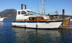 Twin 350 Chev motors, runs like a dream, gen set, 2 heads with holding tanks, aft cabin sleeps 2, master stateroom, salon & renovated galley. Has been boathouse kept for 30 years, fully updated and beautifully maintained. $28,500, OBO. Trade for truck or