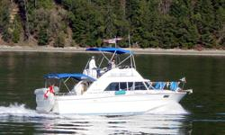 32 foot twin Chrysler 318 engines. Hot and cold running water, fridge, stove and microwave are all ready for you to head out on the sea or lake. This beautiful boat boasts a command bridge that is fully canvased and the cruiser comfortably sleeps 4.