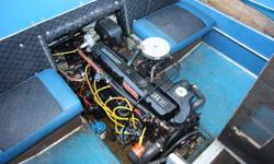 Older but solid Hourston Glasscraft. Powered by 165hp Mercruiser motor. Also has small (believe 8hp) 1978 Mercury kicker which still runs but could do with some tlc. Comes with Road runner single axle trailer which has 12v electric winch and hydraulic