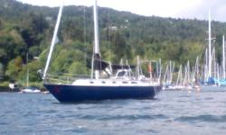 """I have a 1978 """"Islander 36"""". F/G blue hull white decks. Aluminum keel step mast, all standing and running rigging is in good condition, with a self furling head sail and lazy jacks for the main sail. The interior has a large in counter fridge, stainless"""