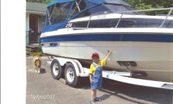 blue/white two sets of covers one net screening , one canvas, 305 cobra engine less then 100 hours use, very good on gas, trailer include, from Ontario never seen salt water yet, has cabin in front, plus cleaning sink for your catch under seats no emails